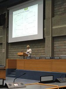 Mary Dinsmore gives a podium presentation at IPS 2018 in Nairobi, Kenya.