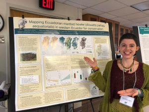 Irene Duch Latorre stands in front of her poster for the 2018 MPIG conference.