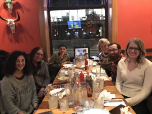 Members of the Strier Lab at a table in a restaurant